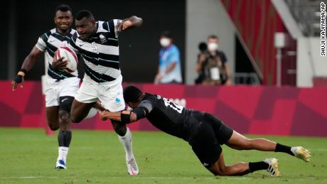 New Zealand's Sione Molia goes for the tackle on Asaeli Tuivuaka.