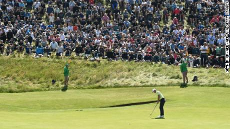 McIlroy putts on the 6th green during his second round of The  Open.