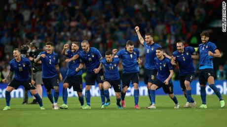 Italy players celebrate winning the penalty shootout against England.