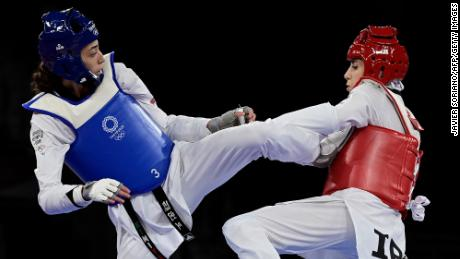 Refugee Olympic Team's Kimia Alizadeh (Blue) and Iran's Nahid Kiyani Chandeh (Red) compete in the taekwondo women's -57kg elimination round bout during the Tokyo 2020 Olympic Games at the Makuhari Messe Hall in Tokyo on July 25, 2021.