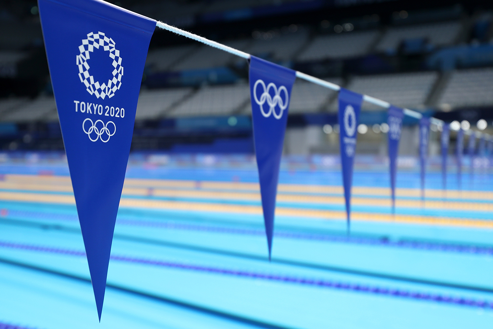 Flags hang over the pool during aquatics training at the Tokyo Aquatics Centre ahead of the Tokyo 2020 Olympic Games on July 22, in Tokyo, Japan.