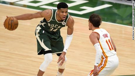 Antetokounmpo sets up a play against Trae Young of the Atlanta Hawks during Game 1 of the Eastern Conference Finals.
