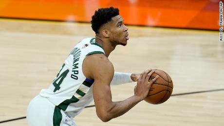 Milwaukee Bucks forward Giannis Antetokounmpo shoots a foul shot during the first half of Game 1 of basketball's NBA Finals against the Phoenix Suns, Tuesday, July 6, 2021, in Phoenix.