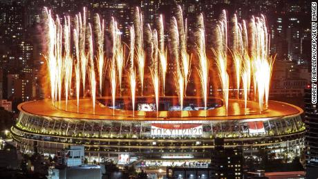 Fireworks light up the sky over the Olympic Stadium during the Tokyo Olympics Opening Ceremony.