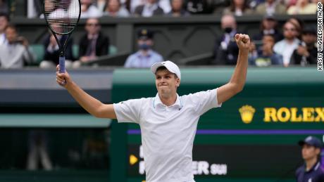 Hubert Hurkacz celebrates after beating Roger Federer to reach the Wimbledon semifinals.