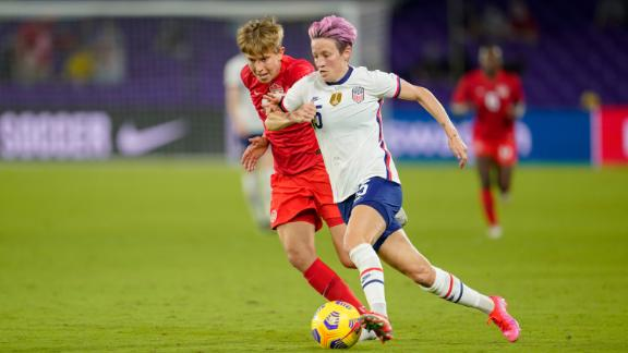 Megan Rapinoe (right) flies past Quinn of Canada during a game between Canada and the US Women's National Team in Florida.