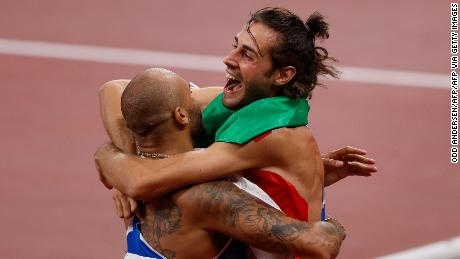 Jacobs (left) and Tamberi embrace  after the men's 100m final.