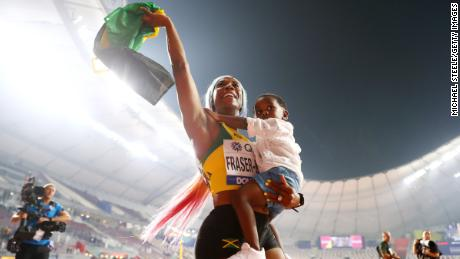 Shelly-Ann Fraser-Pryce of Jamaica celebrates her incredible comeback to the track with her son Zyon, after winning the women's 100m final at the 2019 World Athletics Championships in Doha.