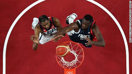 Durant and France's Moustapha Fall go for a rebound.