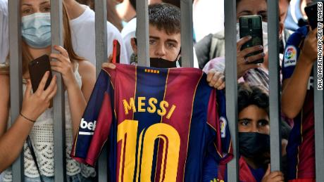 Fans gathered outside the Camp Nou stadium where Lionel Messi held his press conference in Barcelona.