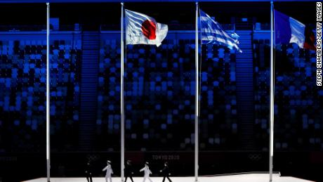 The national flags of Japan, Greece and France fly during the Closing Ceremony of the Tokyo 2020 Olympic Games at the Olympic Stadium on August 08, 2021.