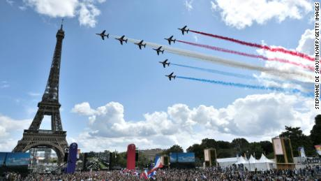 The French Air Force's aerobatic team -- 'Patrouille de France' -- flies over the fan village of The Trocadero set in front of The Eiffel Tower on August 8, 2021.