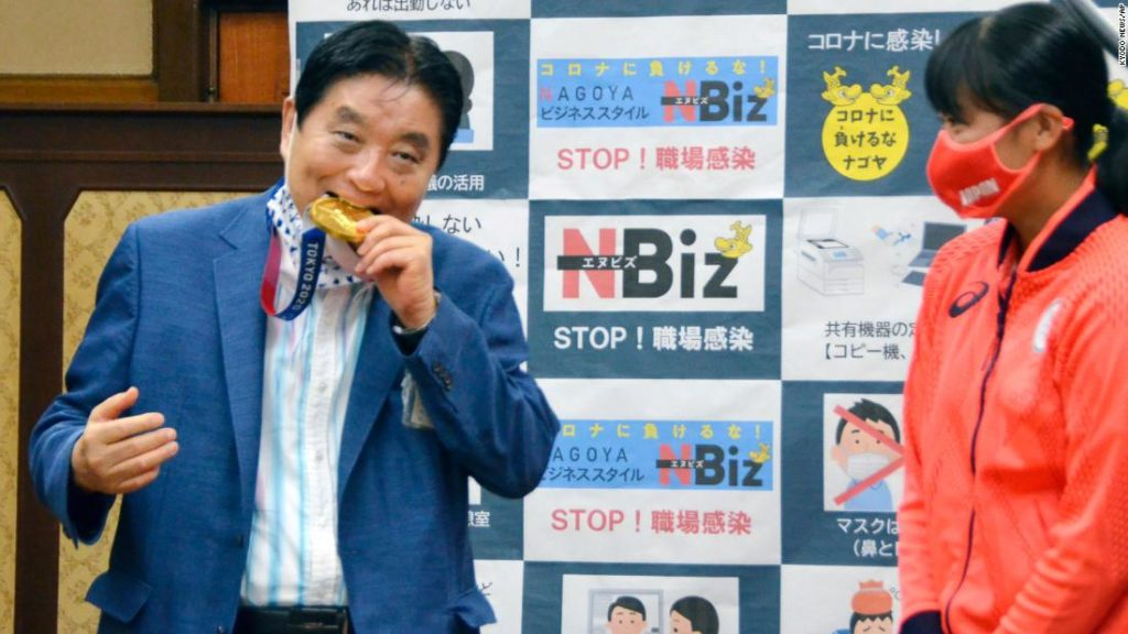 Olympics to replace Japanese athlete's gold medal after mayor bites into it