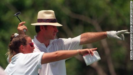 Sunesson points with Nick Faldo during a round.