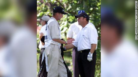 Ian Woosnam (right) stands with his caddie Miles Byrne as he explains his error during the final round of the 2001 Open Championship at Royal Lytham and St Annes.