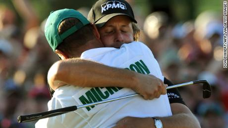 """Mickelson hugs his caddie Jim """"Bones"""" Mackay after sinking his putt on the 18th hole to win the 2010 Masters."""