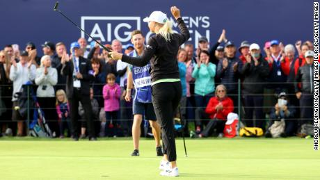 Nordqvist celebrates on the 18th green with her caddie.