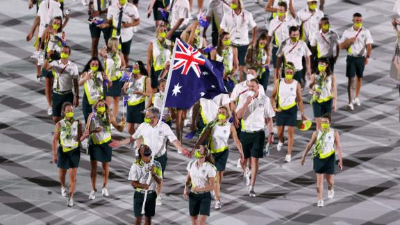 Flag bearers Cate Campbell and Patty Mills of Team Australia lead their team in during the Opening Ceremony of the Tokyo 2020 Olympic Games at Olympic Stadium on July 23, 2021.