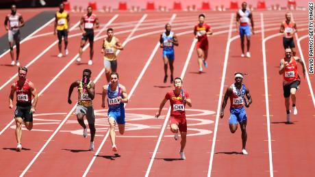 Athletes compete in round one of the men's 4x100m relay heats.