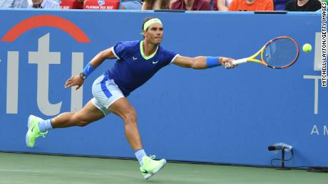 Nadal tries to return a shot during his match against Lloyd Harris at the Citi Open.