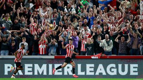 Brentford's Christian Norgaard, center, celebrates after scoring his side's second goal against Arsenal.