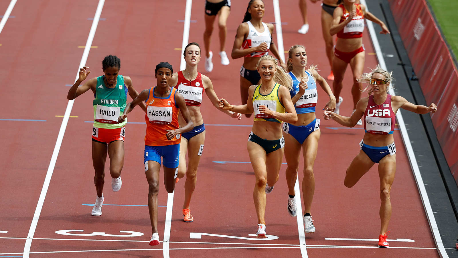 Sifan Hassan crosses the line to finish first during a 1,500 meter heat on Monday.