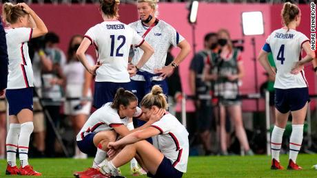 Kelley O'Hara, left, talks to teammate Lindsey Horan after the USWNT's defeat.
