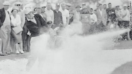 Palmer plays a shot from the bunker at the seventh hole at the Desert Inn Country Club.