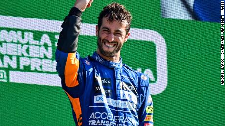 Ricciardo celebrates on the podium after winning the Italian GP.