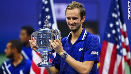 Medvedev celebrates with the US Open tophy -- his first major title.