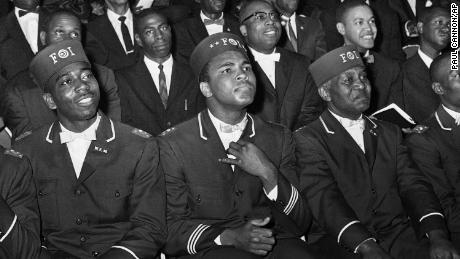 Ali, who joined the Nation of Islam in the early 1960s, listens to then-leader Elijah Muhammad as he speaks to other Black Muslims in Chicago in 1966.