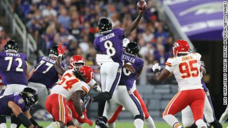 Jackson throws a touchdown while midair against the Chiefs.