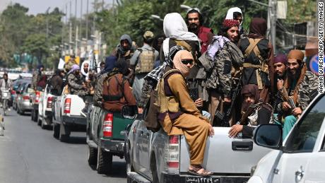 A convoy of Taliban fighters patrol along a street in Kabul on September 2, 2021.