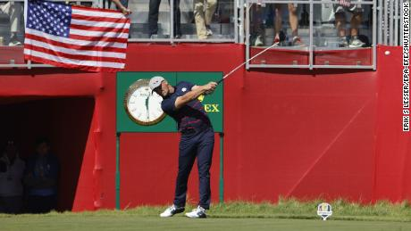 DeChambeau hits his tee shot on the first hole during the Fourball matches.