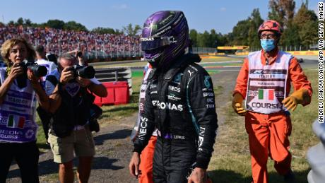 Hamilton walks out of the track after a collision with Verstappen.