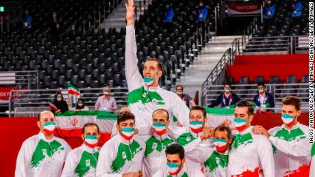The Iranian team celebrates successfully defending its sitting volleyball title at the Paralympics.