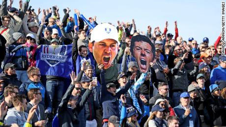 European fans display giant pictures of Rory McIlroy and Sergio Garcia during the morning fourball matches of the 2018 Ryder Cup at Le Golf National.