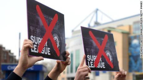 Chelsea fans protest against the proposed European Super League prior to the Premier League match between Chelsea and Brighton & Hove Albion at Stamford Bridge on April 20, 2021.